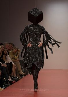 Please design a hat to hide my face so I don't have to be seen in this awful creation! Gareth Pugh