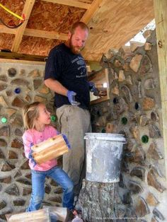 Katy is an enthusiastic cordwood mason and has the next log end ready for Dad to mortar.