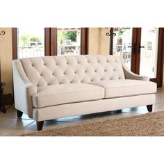 Provide your home with the beauty and elegance of this Abbyson Living Claridge sofa. This beige velvet fabric tufted sofa is complete with espresso finished birch wood legs.