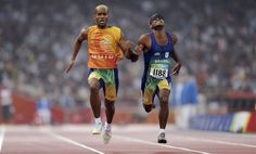 Blind athletes running with a guide. Paralympic Sports.