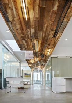 This gorgeous reclaimed wood panel from century-old New York City water towers beautifully accentuates this modern workplace.