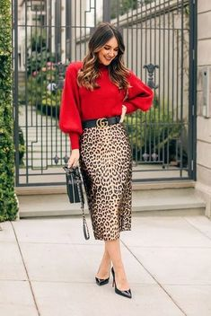 Red balloon sleeve sweater a leopard skirt a black logo belt black patent heels and a black chain strap bag. holiday outfit holiday look christmas outfit new years eve outfit fashion 2018 party outfit holidaystyle partystyle holidayoutfit Printed Skirt Outfit, Printed Skirts, Skirt Outfits, Dress Skirt, Maxi Dresses, Midi Skirt, Sweater Outfits, Jeggings Outfit, Bar Outfits