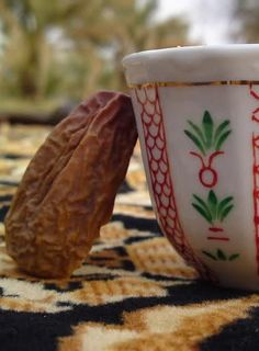 cup of arabic coffee & date