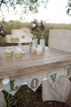 Vintage Woodlands Wedding Inspiration   Confetti Daydreams - Outdoor vintage-inspired table setting with glass vases, cutting cake and cupcakes ♥ #Vintage #Wedding #Ideas #Inspiration