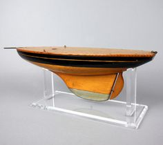 Small varnished and painted pond yacht hull, 1920 England