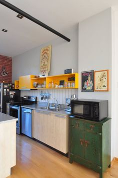 Love the colorful storage choices in Julien & Andre's kitchen!