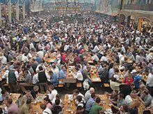 enjoy a beer at Oktoberfest in Germany