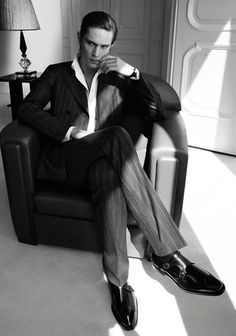 I really don't like when men sit with their legs crossed, but this guys looks pretty good doing it. LOL!