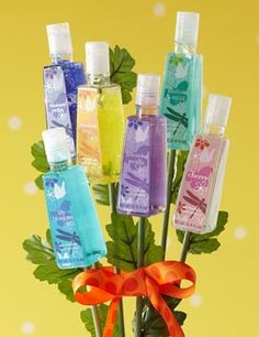DIY Hand Sanitizer Bouquet:  Paint 6 wooden dowels of varied heights with green craft paint and let dry. Hot glue a different scented hand sanitizer to each dowel, then carefully insert dowels into a sand-filled glass or ceramic vase, filling in with faux foliage stems. Finish off with a colorful bow, silk butterfly or other decorative accent.