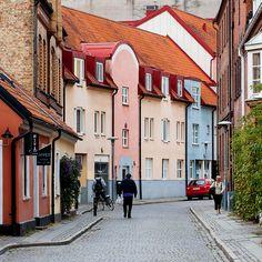 """Stora Fiskaregatan,"" by Rutger Blom, via Flickr -- Pastel beauties on a cobblestone street in Lund, Sweden"