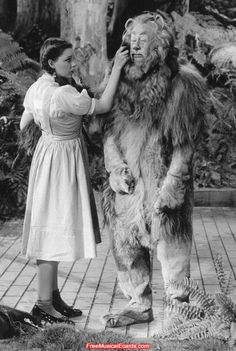 This time Judy Garland as Dorothy keeps a straight face while wiping away the Cowardly Lion's tears behind the scenes on the set of The Wizard of Oz.