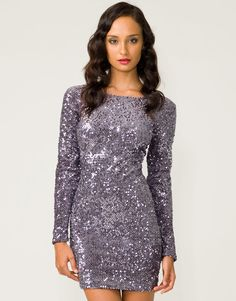 Motel Gabby   Show stopping glitzy dress featuring all over silvery grey metallic sequins with long sleeves, low v exposed back, bodycon styling and in a luxuriously thick velvety fabric. This layered sequin mini dress is PERFECT for the party season, team this Motel dress with killer platform courts, black suspender tights and a patent clutch for a modern spin on vintage Hollywood glamour.
