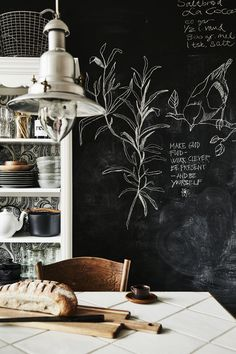 Inspiring kitchen with a chalkboard on the walls.