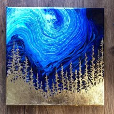 This year, I discovered abstract painting using fluid acrylics. I love the organic feel of this medium and the way it makes images that looks like things in nature. This one looks like the forest against a night sky to me, and I've finished it with composite gold (zinc + copper) metal
