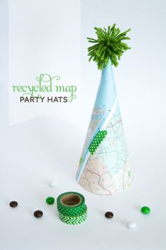 Party hats made with maps. Use for a going away or bon voyage party. Or a travel-themed party...treasure maps, etc.