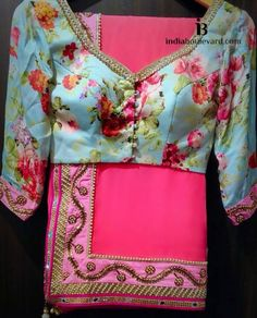 Powder blue v-neck blouse & floral prints paired with a coral pink saree. Blouse Neck Designs, Kurta Designs, Blouse Patterns, Indian Blouse, Indian Sarees, Indian Attire, Indian Wear, Indian Dresses, Indian Outfits