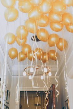 Different party decor idea - cover the ceiling with balloons and curl the ribbon ends for an ethereal feel.