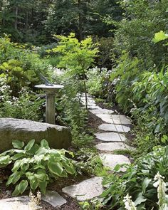 Designing with Stone - Rock can make digging difficult, but it ensures a steady supply of stone for working into garden design, as shown in this simple path cutting through a perennial bed.