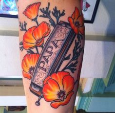 can't believe someone got this tattoo..totally describes papa schultz. harmonicas and flowers!