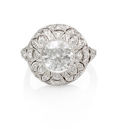 An Art Deco diamond ring in domed openwork setting. The ring is set with an old European cut diamond weighing 1.56 ct., G VS1 (with GIA report) in platinum. Approx. total carat weight 2.25 ct. Unsigned Tiffany. Ring was reshanked.