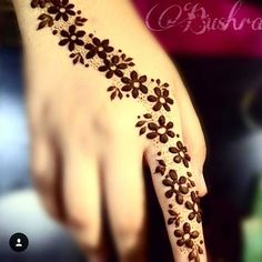 You HAVE to see these Minimal new mehndi design ideas for this wedding season! Party the mehndi party away with these back of the hand henna ideas! Henna Flower Designs, Mehndi Designs Finger, Mehndi Designs For Beginners, Mehndi Designs For Fingers, Unique Mehndi Designs, Beautiful Henna Designs, Simple Mehndi Designs, Mehandi Designs, Mahendi Designs Simple