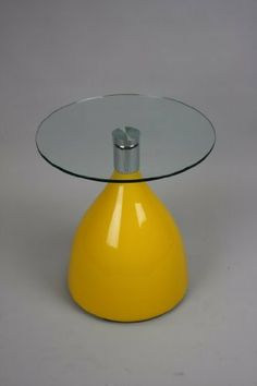 "19"" Round Side Table - Yellow Candy Drop Base by Manhattan Modern. $115.00. Perfect for a cozy corner designed for drinks, snacks and coffee. 21"" Height. Available in various colors. 19"" round table with ""candy drop"" base, a great accent to any room. Eye catching and fun. This ""candy drop"" base table brings color and flair to any room it graces. This side table stands 21 inches tall and sports a 19 inch diameter glass top.. Save 15%!"