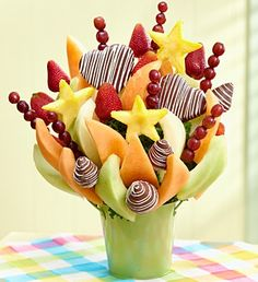 That's My Baby™ - Juicy strawberries dipped in milk chocolate with white swirls, honeydew melon and cantaloupe wedges, pineapples shaped like small stars $64.99 #chocolate #fruit #fruitbouquets