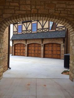 Doortec garage doors custom wood carriage doors. These doors have ruff cedar trim on them with heavy hardware and the homeowner stained the doors.