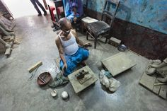 Bangladeshi craftsman modeling little Buddha statues in a small workshop, Hindu Street/Shankaria Bazaar, Dhaka, Bangladesh, Indian Sub-Continent, Asia