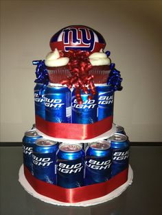 Beer cake !  New york giants colors, bud light and some red velvet cupcakes from retro bakery. Best manly birthday cake ever!