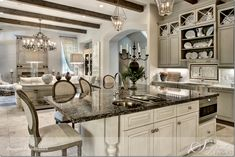 Traditional kitchen with ceiling beams, would need to be modernized.