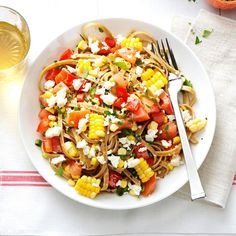 Fresh Corn & Tomato Fettuccine Recipe -This recipe combines delicious whole wheat pasta with the best of fresh garden produce. It's tossed with heart-healthy olive oil, and a little feta cheese gives it bite. —Angela Spengler, Tampa, Florida