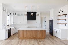 Exclusive Open Concept 2-Bed New American Farmhouse with Home Office - 365005PED | Architectural Designs - House Plans Home Room Design, House Design, White Built Ins, Black Kitchen Island, American Farmhouse, Open Concept Floor Plans, The Gables, Walk In Pantry, Great Rooms