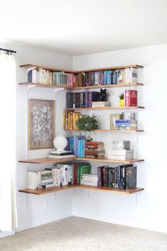 DIY Wall-Mounted Shelving Systems Easy to Install One of my favorite small space hacks is swapping your bookcases for wall-mounted shelving. We've created roundups of wall mounted shelving systems before, but for those of you who are especially crafty t Wall Mounted Shelves, Interior Design, Shelves, House Interior, Home Deco, Shelving, Home, Small Spaces, Interior