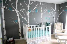 Baby Nursery, White Trees And Blue Birds Theme Wall Decals Also Rectangle Black Storage Box With White Oak Laminate Crib And Blue Bedding Set With Yellow Winnie The Pooh Dool And White Leather Arm Chair With Ottoman: Baby Nursery Theme And Design Ideas For Your Plan