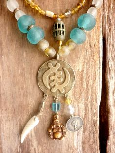 African Boho Yellow, Blue and White necklace with gorgeous Brass pendant with Buddha - PEACEFULL - Bohemian jewelry & African jewelry   by DazzlingDivaJewels, $197.00  Designed & Created by Patrice
