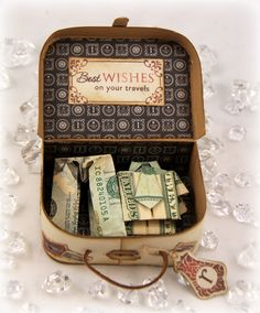 MONEY-FILLED VINTAGE SUITCASE - Love the origami clothes!