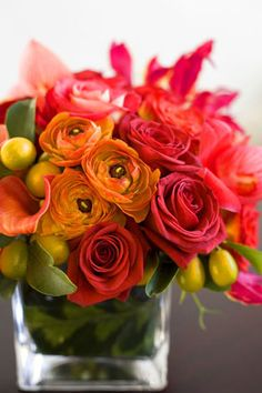 Infuse Spring colors into your event! Arrangement by our friends at Fleurish.