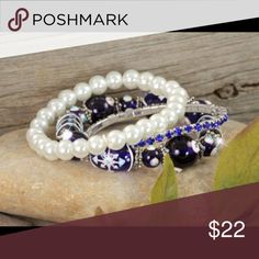 Three bracelets with hand painted snowflake beads. Beautiful set of three festive stretch bracelets featuring royal blue crystals, shimmering white pearls, and hand-painted blue and white snowflake glass beads.  Coming Soon! Jewelry Bracelets