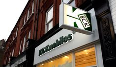 Illuminated shop sign and projecting light box for Kick Mobiles company in London