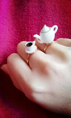 Tea pot set rings.  HaHa these made me laugh.. I would never wear them, still made me laugh tho.