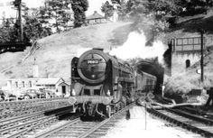 Britannia 70012 John of Gaunt arriving at Ipswich Station through the Stoke Hill tunnel in the 1950s, with the Liverpool Street to Norwich express