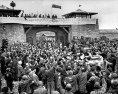 Mauthausen, Austria, The camp inmates welcoming the US Army, 06/05/1945.  The soldiers are from the 65 Infantry Division of the US Army. The soldier on the tank, on the left, is Maurice Handelman, a Jewish soldier in a patrol unit, who was the first to open the camp gates and enter it on that day. According to P. Serge Choumoff, an historian and survivor of Mauthausen, this event was recreated one day after the actual liberation, at the request of General Eisenhower.