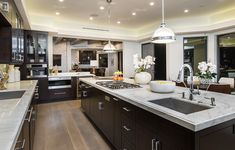 The gourmet kitchen is filled with calacatta marble countertops, Wolf appliances and a wall of Fleetwood doors that open onto a terrace for lounging with expansive ocean views. 534 Crestline Dr | Brentwood
