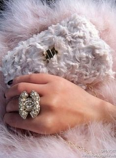 Super amazing close-up of Chanel tiny purse and signature ring. OMG. What I wouldn't give for that ring!