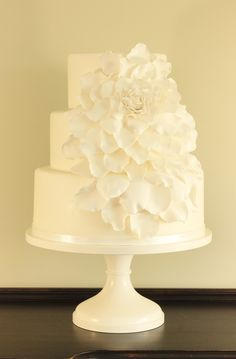 I had seen several versions of this design before this bride presented it to me at our consult and was excited to have an opportunity to make one.  Just loved putting this together. Gumpaste petals with a little pearl dust for highlights.