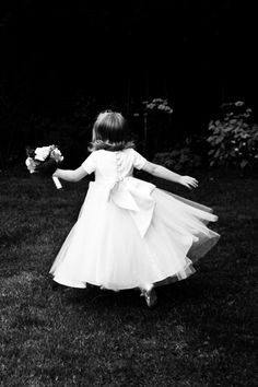 Black and White wedding photography of a bridesmaid captured in full flight by Cheltenham photographers Jane and Oli