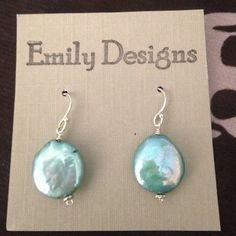 Sterling silver blue coin pearl earrings Simple, stunning, summery. These sterling silver and freshwater coin pearl in aqua are the next thing for your summer closet. Hand made by me, Emily. Jewelry Earrings