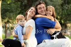 Cute family pose by PureJoy Photography