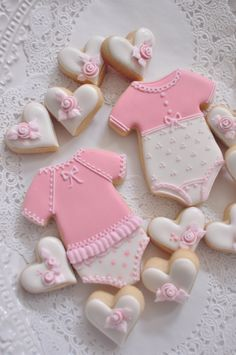 12 Girl's Onesie Cookie Favors - for baby showers or birthdays, baby onesie cookies by MarinoldCakes on Etsy https://www.etsy.com/ca/listing/206195031/12-girls-onesie-cookie-favors-for-baby